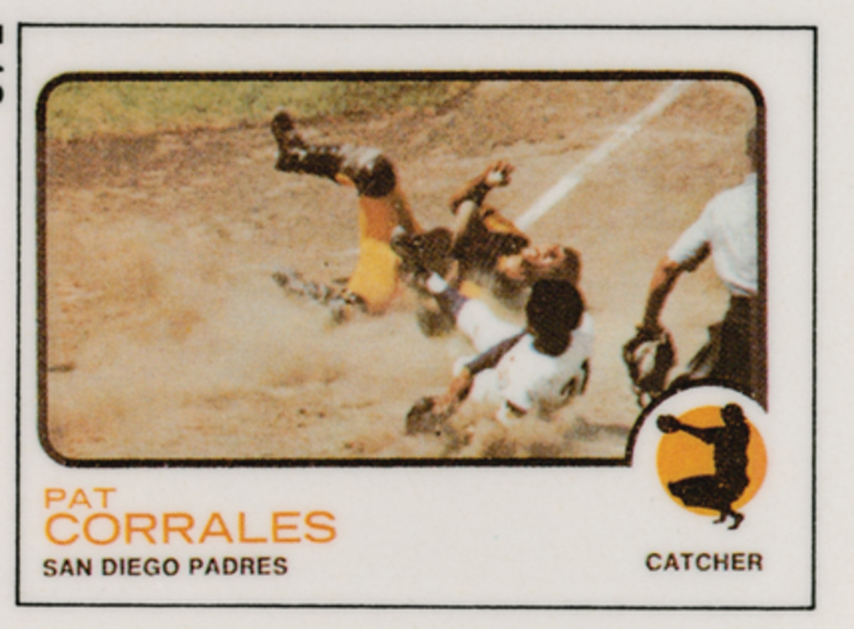Who's that sliding into home plate against Pat Corrales? Hint, it's a Hall of Fame pitcher.