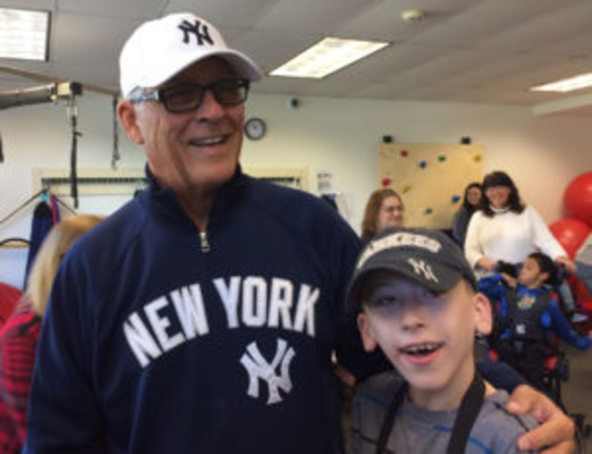 Bucky Dent puts smiles on kids' faces during a visit to the Prospect Center in Queensbury, N.Y. Many children wore Yankees caps and jerseys that Dent autographed. (Paul Post photo)