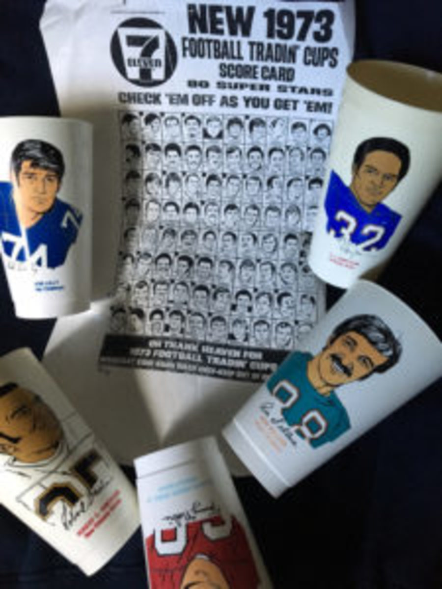 A photocopy of the 1973 Football Slurpee cup checklist and a mix of player cups in the set.
