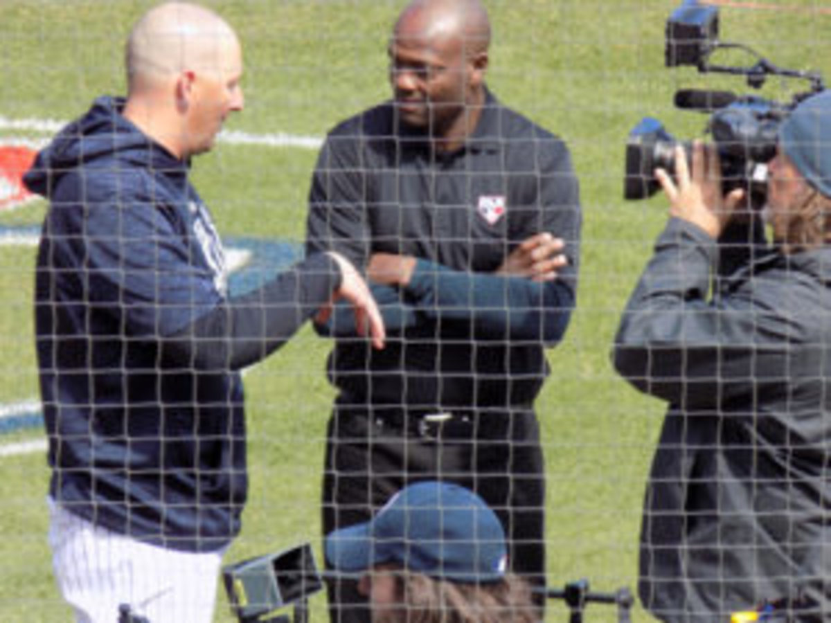 Former major league player and MLB Network's Harold Reynolds (center) at work prior to a Spring Training game.