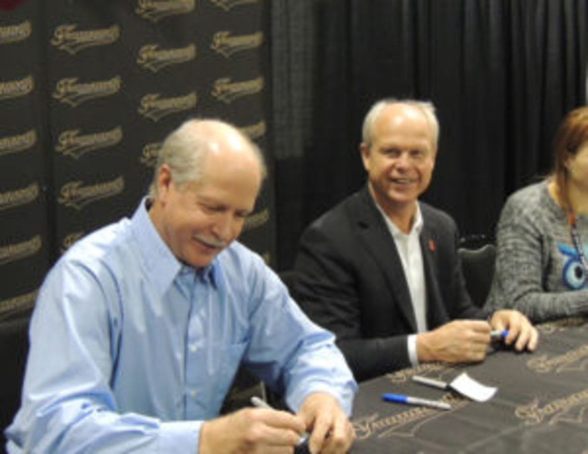Marty Howe (L) and Mark Howe (R) sign autographs at the Toronto Sport Card and Memorabilia Expo.