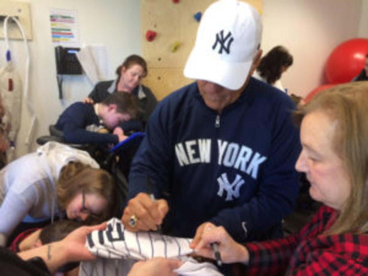 New York Yankees hero Bucky Dent met and signed autographs for young fans during a visit to the Prospect Center for developmentally disabled persons in Queensbury, N.Y. He was also the guest speaker at a fundraising dinner for the Center. (Paul Post photo)