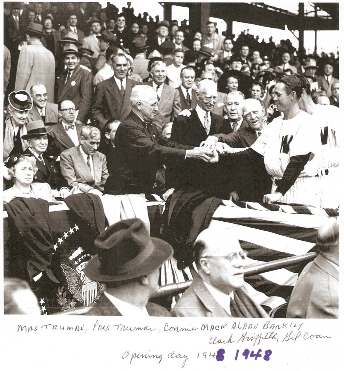 Opening Day 1949, Gil Coan of the Senators hands a ball to President Harry Truman. To the right of Truman are Connie Mack, Vice President Alben Barkley and Clark Griffith. Photo courtesy of Gil Coan.