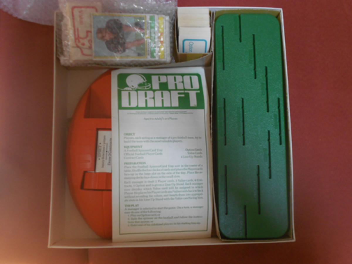 Pro Draft game contents include a football-shaped spinner; four game boards; Value, Option and Contract cards; and 50 alternate Topps football cards.