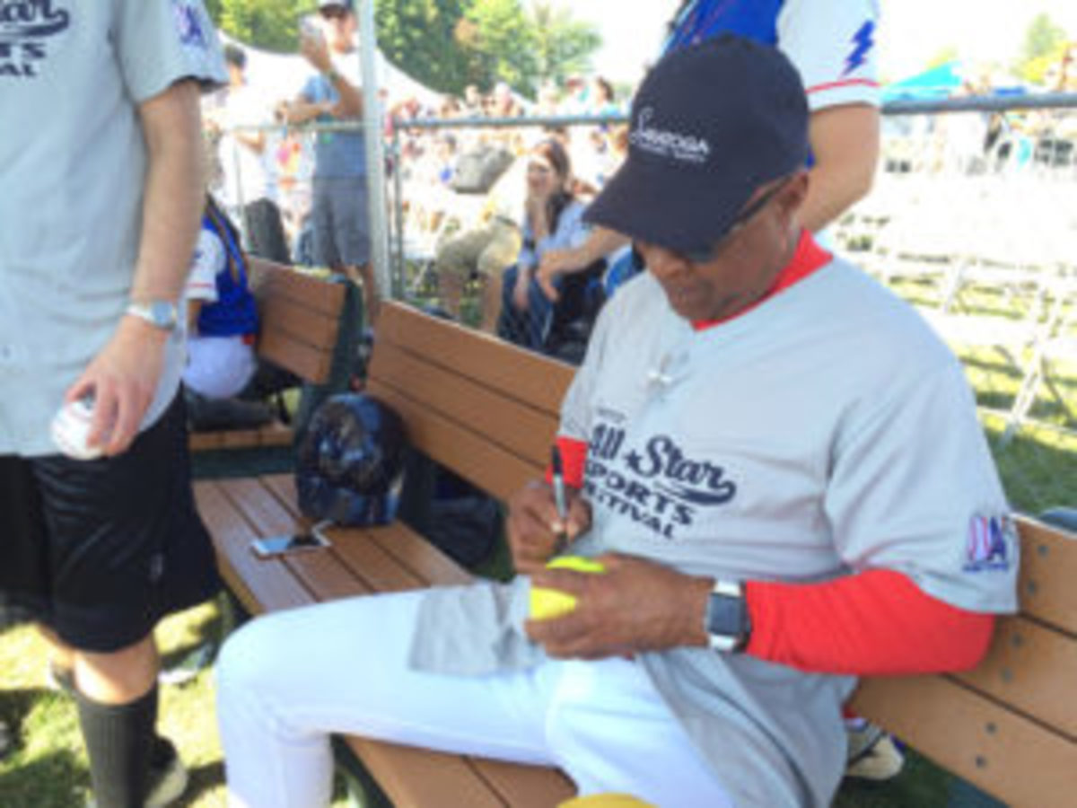 Baseball Hall of Famer Ozzie Smith signed numerous autographs at the All-Star Sports Festival.