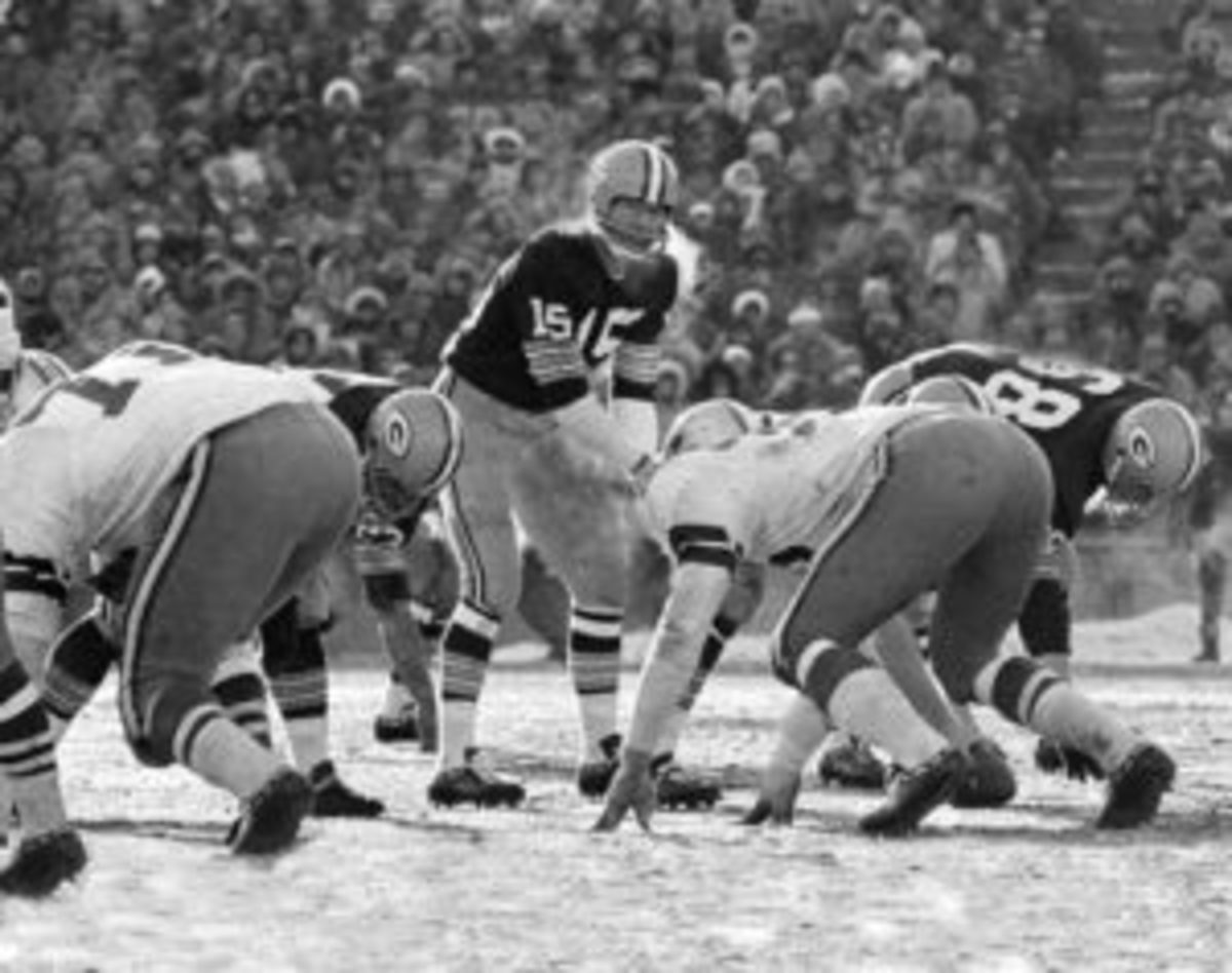 With his breath visible, Green Bay Packers quarterback Bart Starr barks out signals during the Ice Bowl. (AP Photo/File)