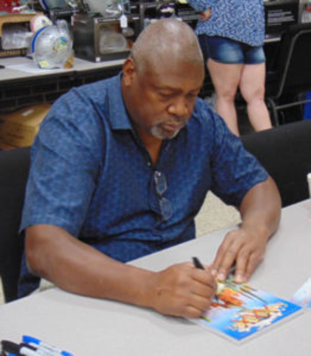 Charles Haley signs an autograph at the Crave the Auto Show in Canton. (Robert Kunz photo)