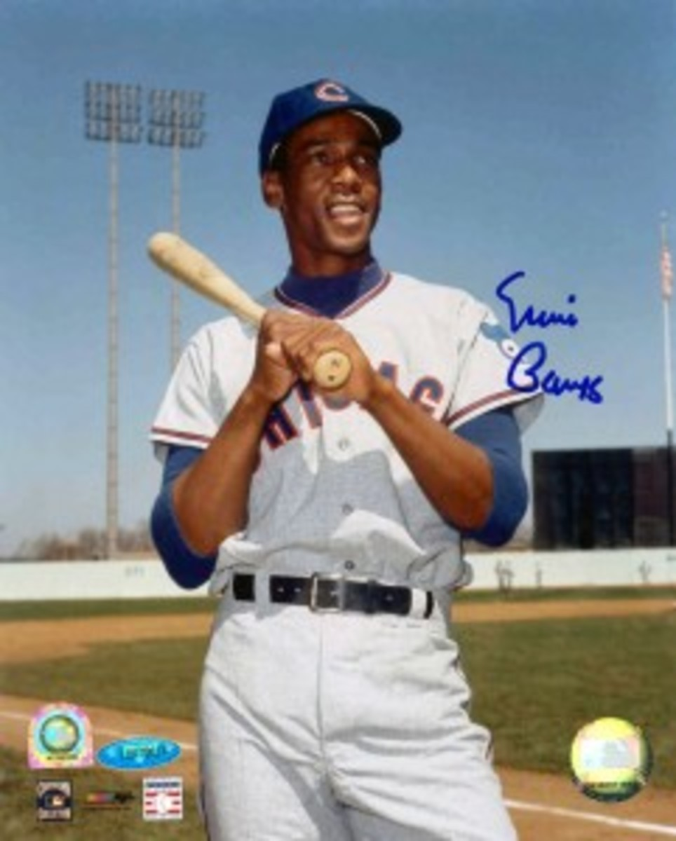 Unless it was during game action, and even then it might be a challenge, there aren't many photos of Ernie Banks in which he isn't smiling.