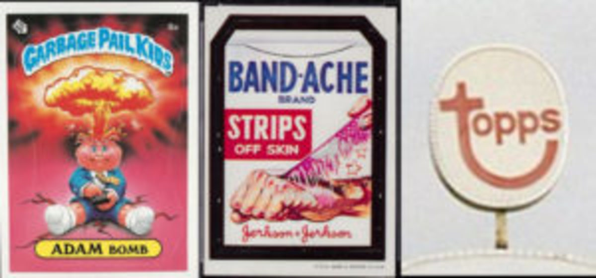 Garbage Pail Kid Adam Bomb, Wacky Pack Band-Ache, and the Topps logo from the Duryea parking lot.
