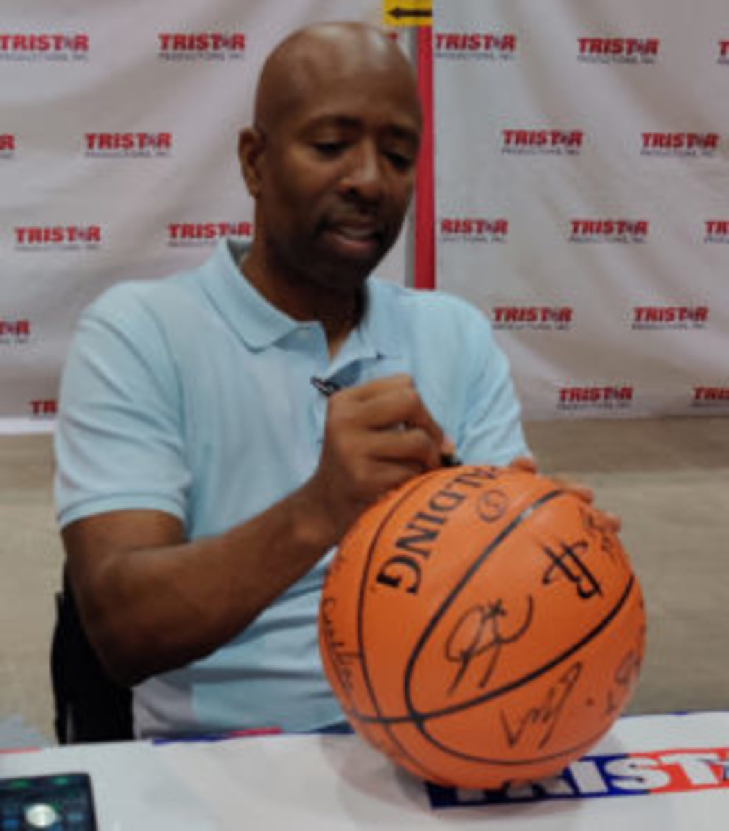 Kenny Smith was one of many members of the Houston Rockets' championship team to sign autographs.