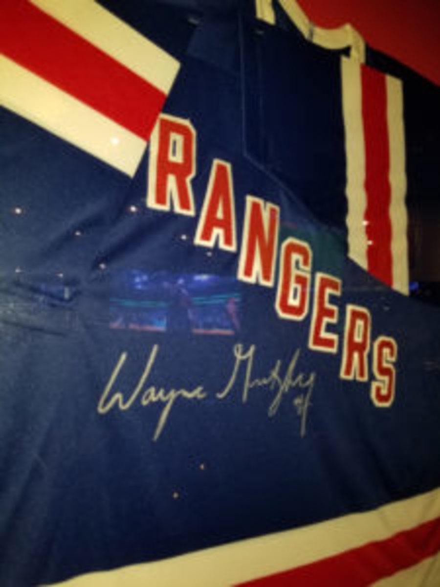 An autographed New York Rangers Wayne Gretzky jersey on display.