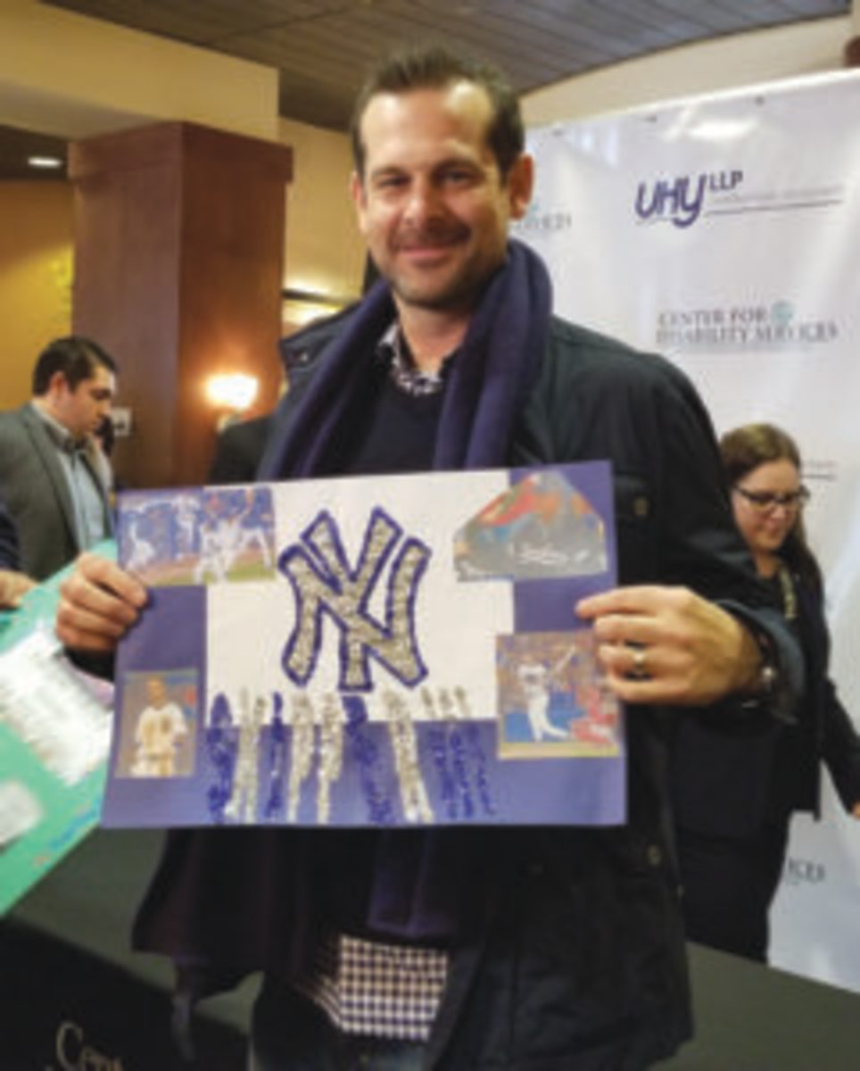 New York Yankees manager Aaron Boone was given a large handmade card made by children during a benefit for the Center for Disabilities in Albany, N.Y. (Paul Post photo)