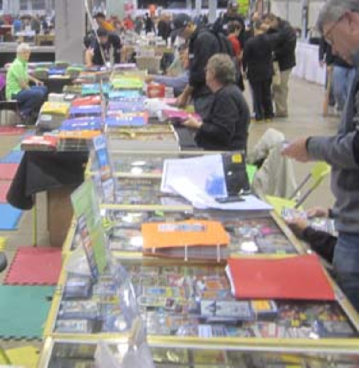 vrecheckDisplay cases, bargain boxes, and binders with priced cards in various grades are all part of what dealers bring to shows.