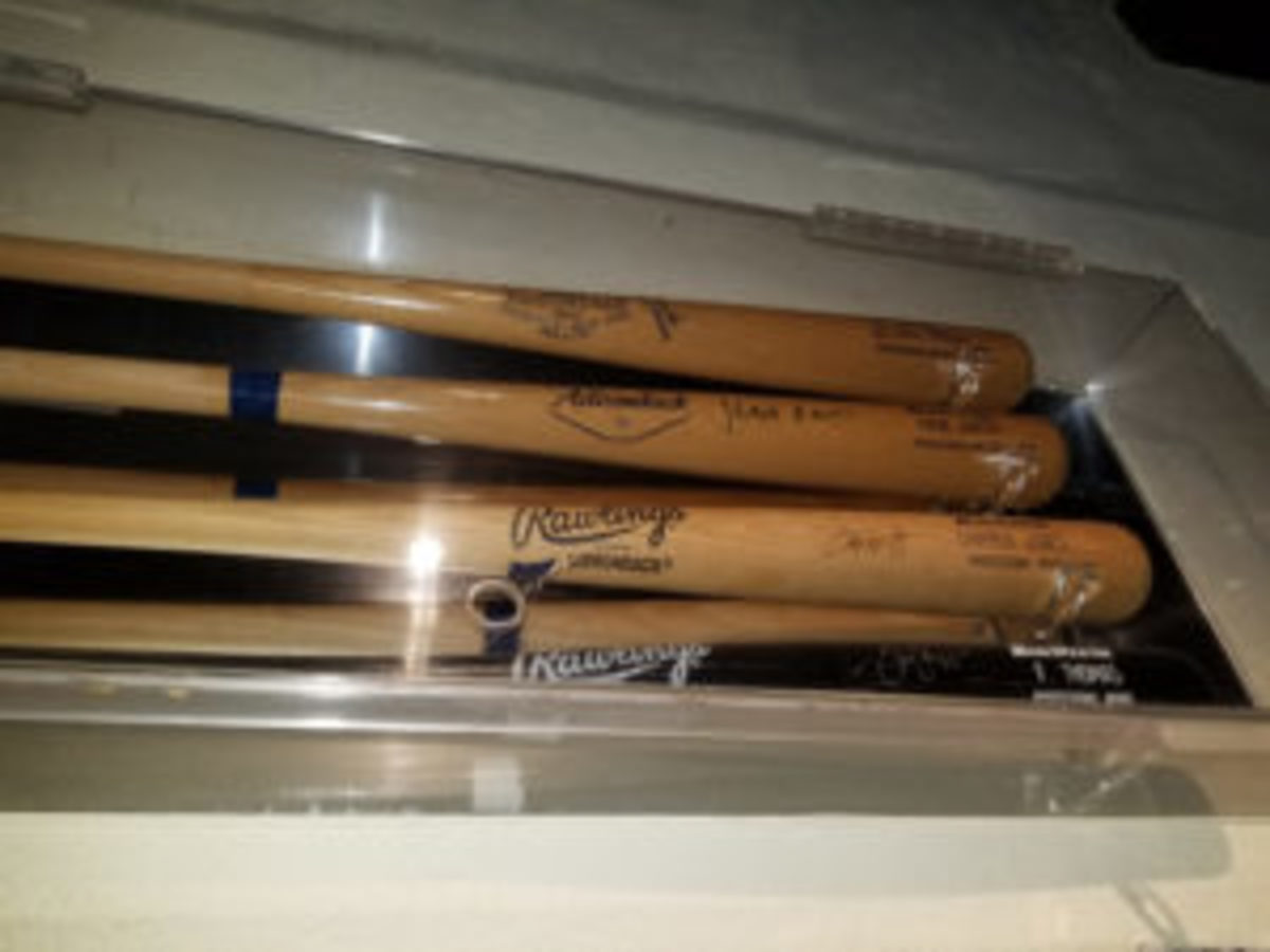 Autographed bats from former major leaguers are displayed in a display case at Champions Sports Bar in Puerto Vallarta in Mexico.