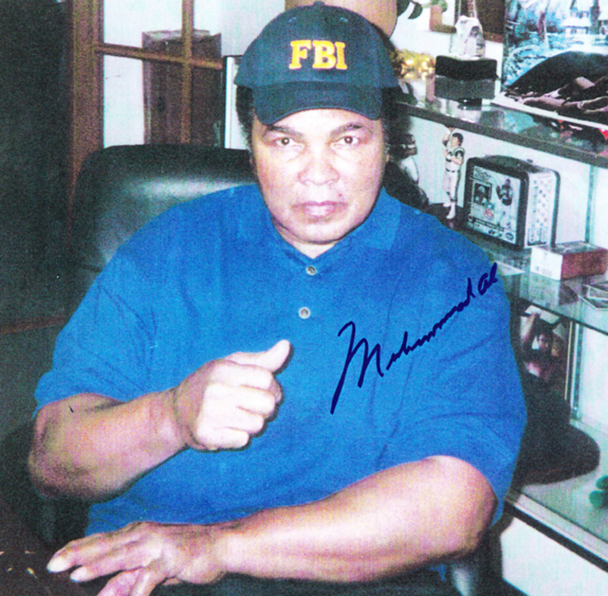 Signed by Ali when he was visiting the FBI, this autograph is real.
