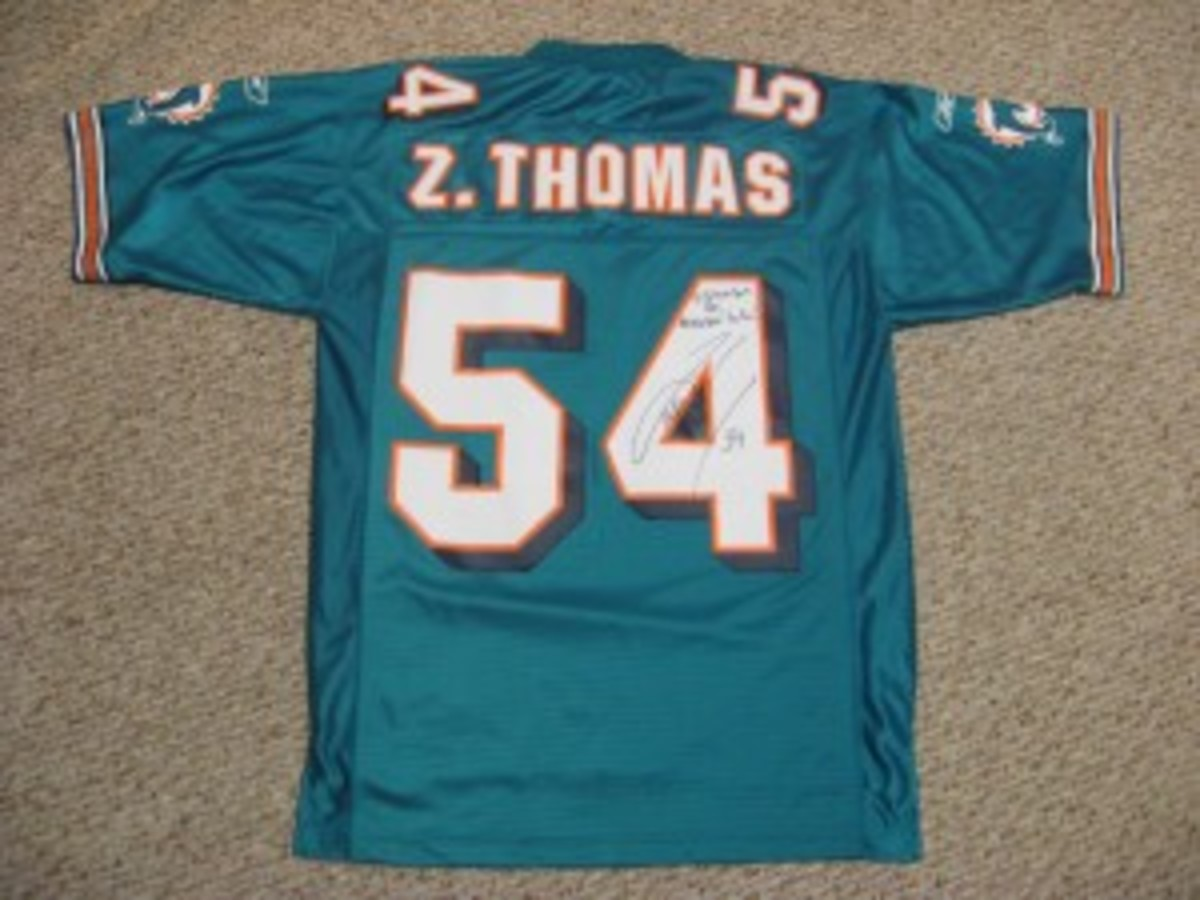 This Zach Thomas jersey, which the linebacker signed through the mail in a great signature, was found at a thrift store for $5.