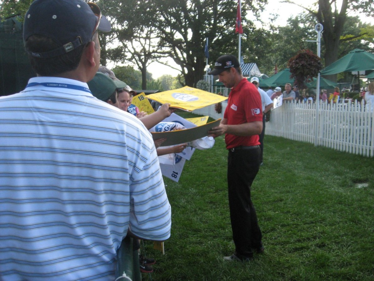 Padraig Harrington did indeed sign after his practice round, especially for kids.