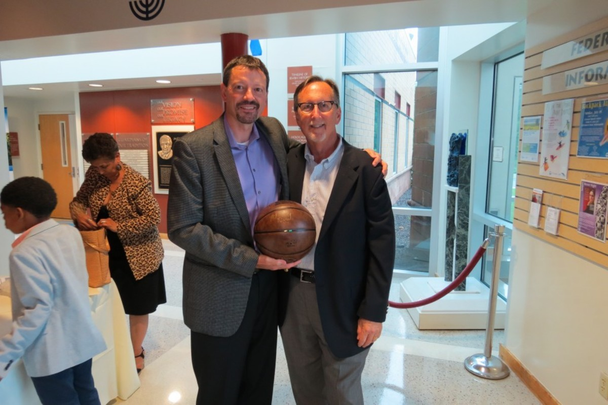 Scott Tarter (left) and John Abrams (right), the president and CEO, respectively, of the Dropping Dimes Foundation, display one of the limited-edition Naismith Memorial Hall of Fame basketballs that were engraved during Slick Leonard's HOF induction ceremony last summer in Springfield. The ball has the name of each of the three ABA Pacers that have been elected to the Hall of Fame (Mel Daniels, Slick Leonard and Roger Brown), and was autographed by Daniels and Leonard.