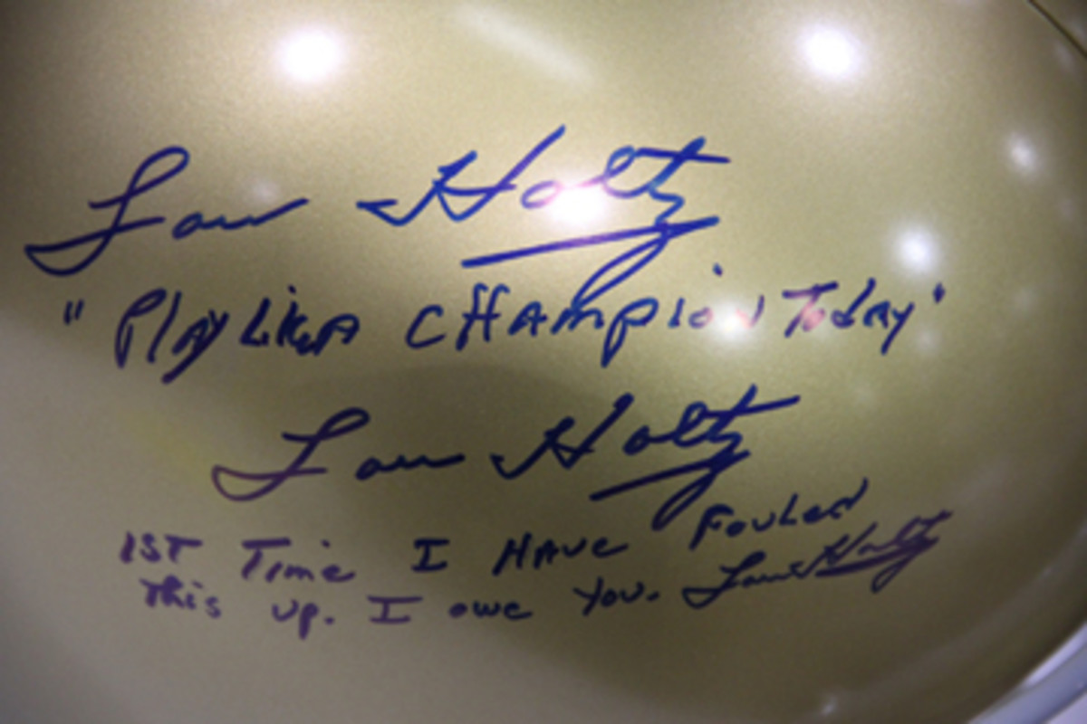 Not all signatures and inscriptions are pulled off without a hitch. Lou Holtz made up for his snafu.