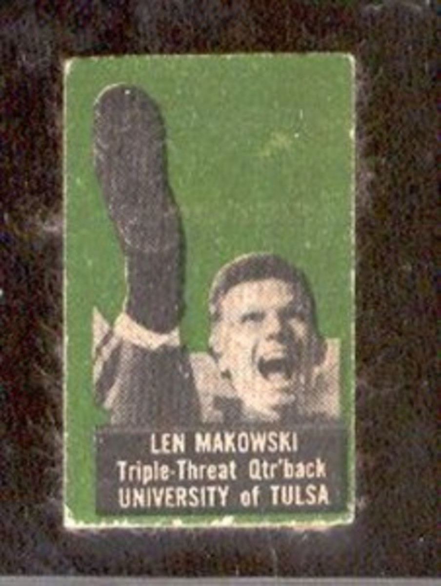 Len Makowski: A vertical card with an awkward kicking pose.
