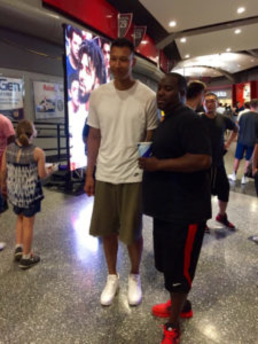 Zhou Qi of China, and a member of the Houston Rockets organization, takes time to pose for a photo with a fan.