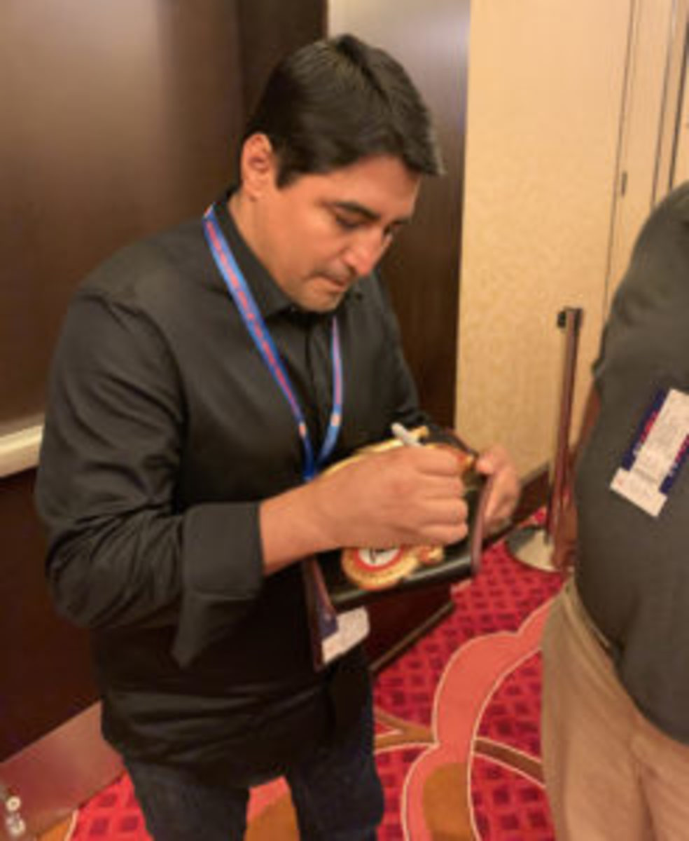 Erik Morales signing autographs for collectors at the VIP Boxing Card Event.