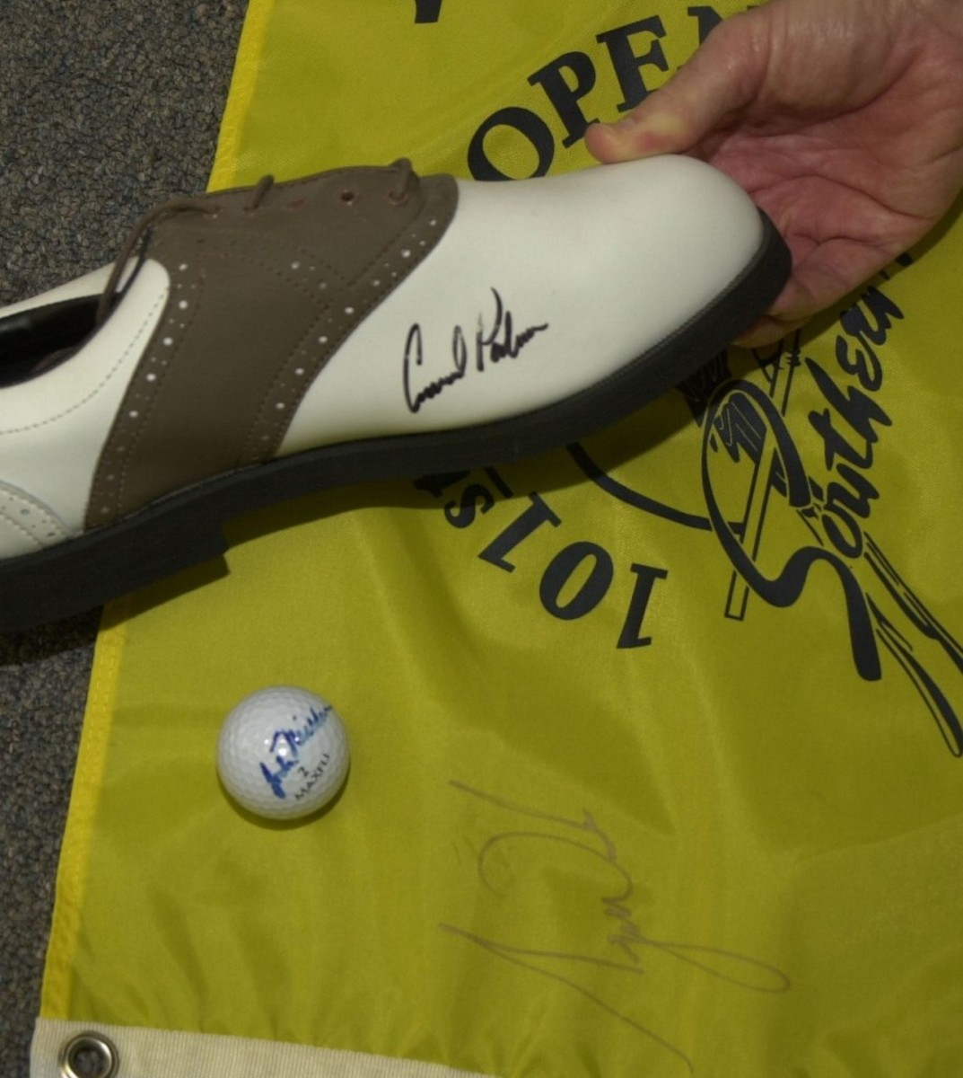 The forged signatures of two of golf's legendary names, Arnold Palmer and Jack Nicklaus.