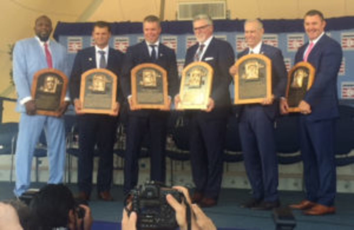 New Baseball Hall of Fame members (left - right) Vladimir Guerrero, Trevor Hoffman, Chipper Jones, Jack Morris, Alan Trammell, and Jim Thome proudly hold their Hall of Fame plaques at the Baseball Hall of Fame Induction Ceremony. (David Moriah photo)