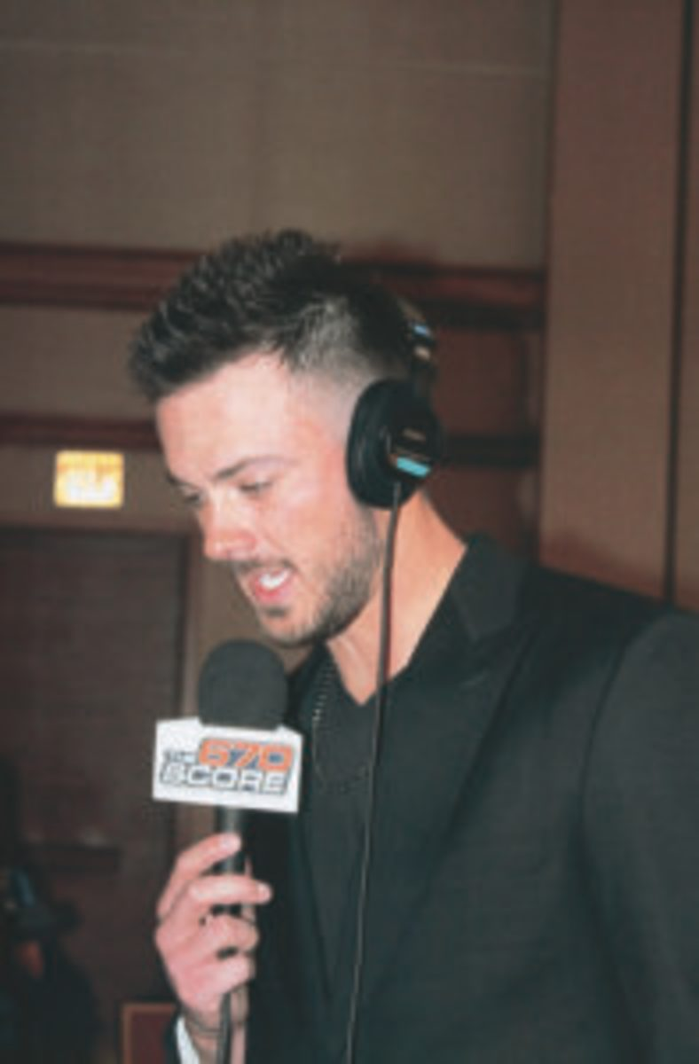 Cubs player Kris Bryant does a radio interview during the 2018 Cubs Convention.