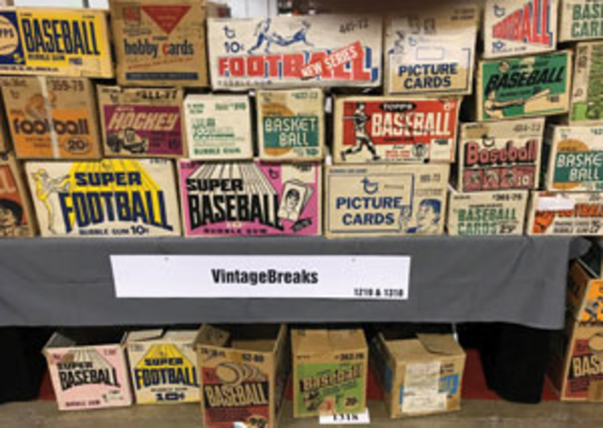 "The Vintage Breaks ""Wall of Wax,"" a display of empty vintage Topps case boxes at the Case Breakers Pavilion."