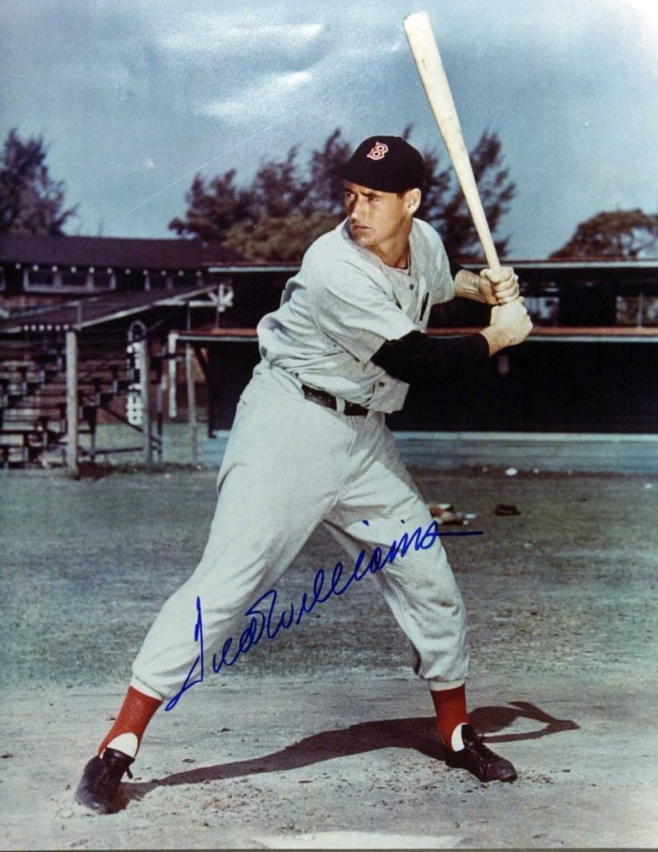 Another classic photo of another all-time great, Ted Williams, with a fake signature.