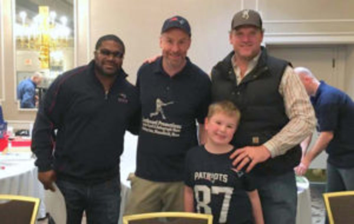 Two Patriots stars, Patrick Pass (far left), and Logan Mankins (far right), with Doug Keating and his son Charlie Keating. (Photos courtesy Doug Keating)