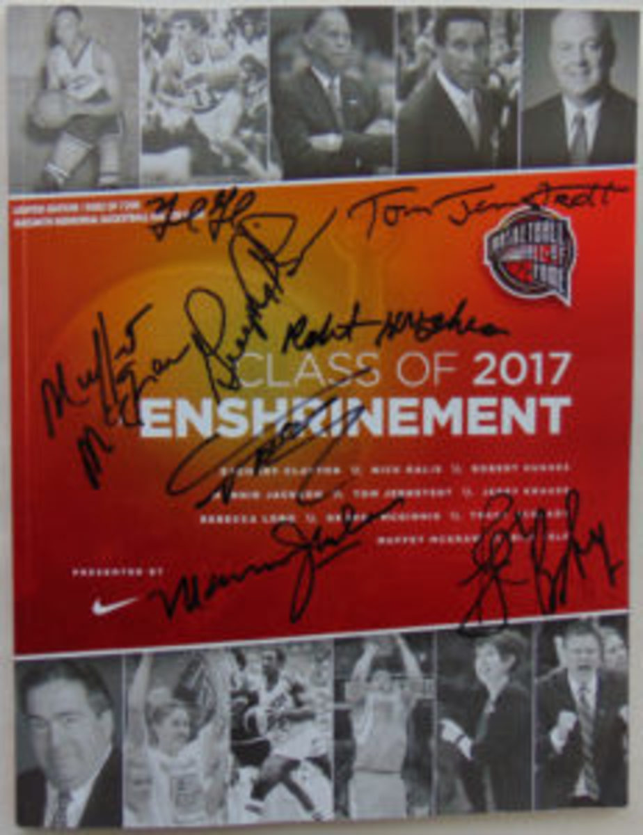 A 2017 Hall of Fame Enshrinement program signed by all nine living members.