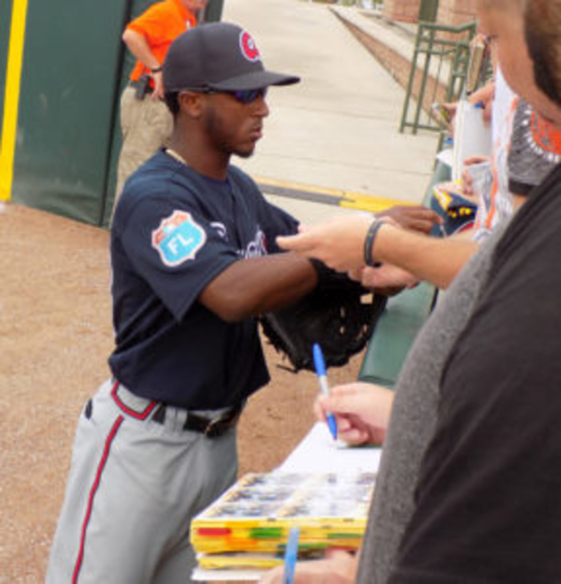 Atlanta Braves second baseman Ozzie Albies signs for fans at spring training.