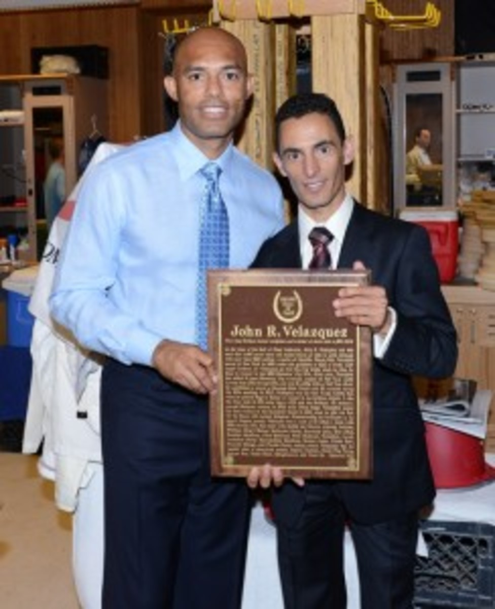 """Rivera appears with jockey John Velazquez after Velazquez was inducted into the National Museum of Racing and Hall of Fame. Rivera made an appearance at Saratoga Race Course and handed out the trophy following the third race on the card, """"The Spa Welcomes Mo!"""""""