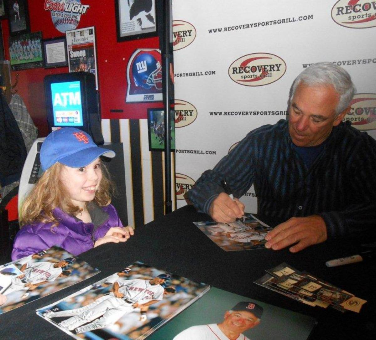 Bobby Valentine signs for fans during a session at Recovery Sports Grill in upstate New York.