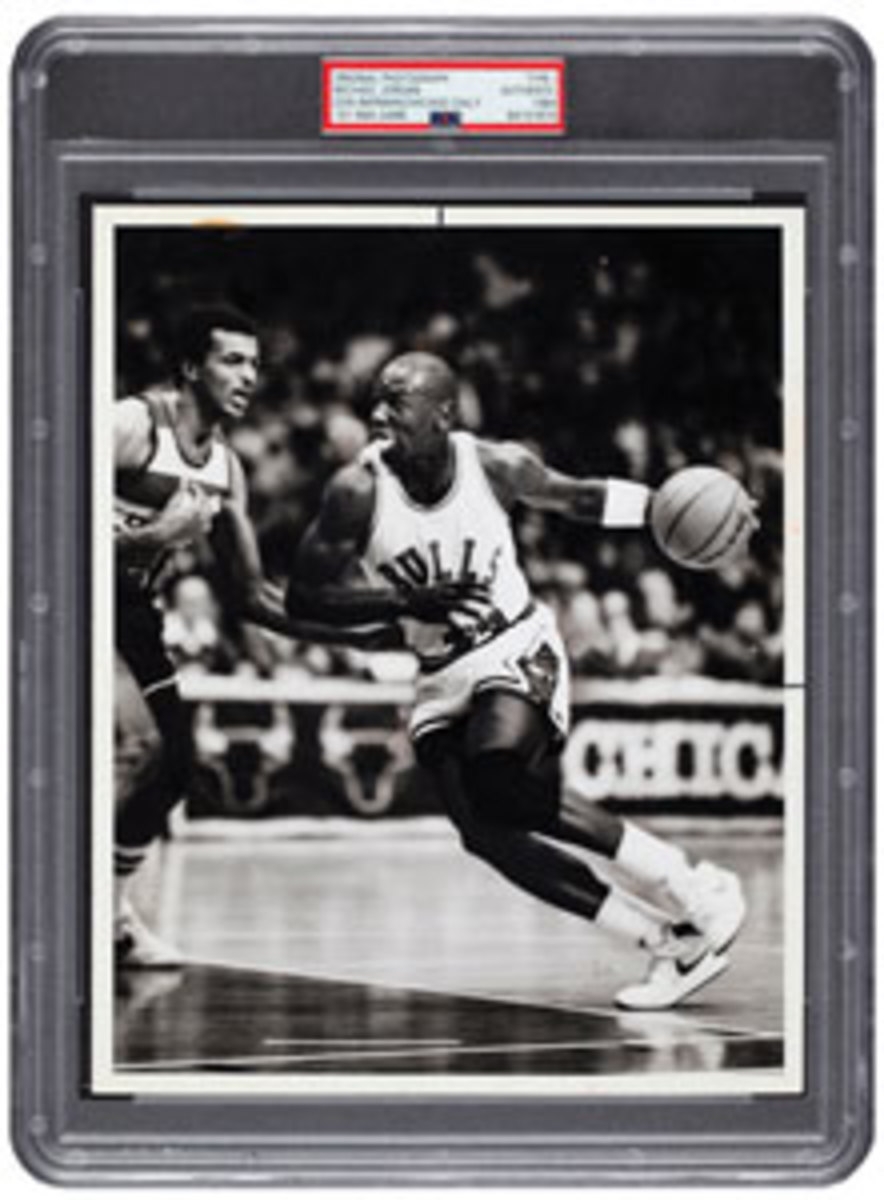 This 1984 Michael Jordan photograph from his first NBA Game, PSA/DNA Type 1, sold for $22,200.