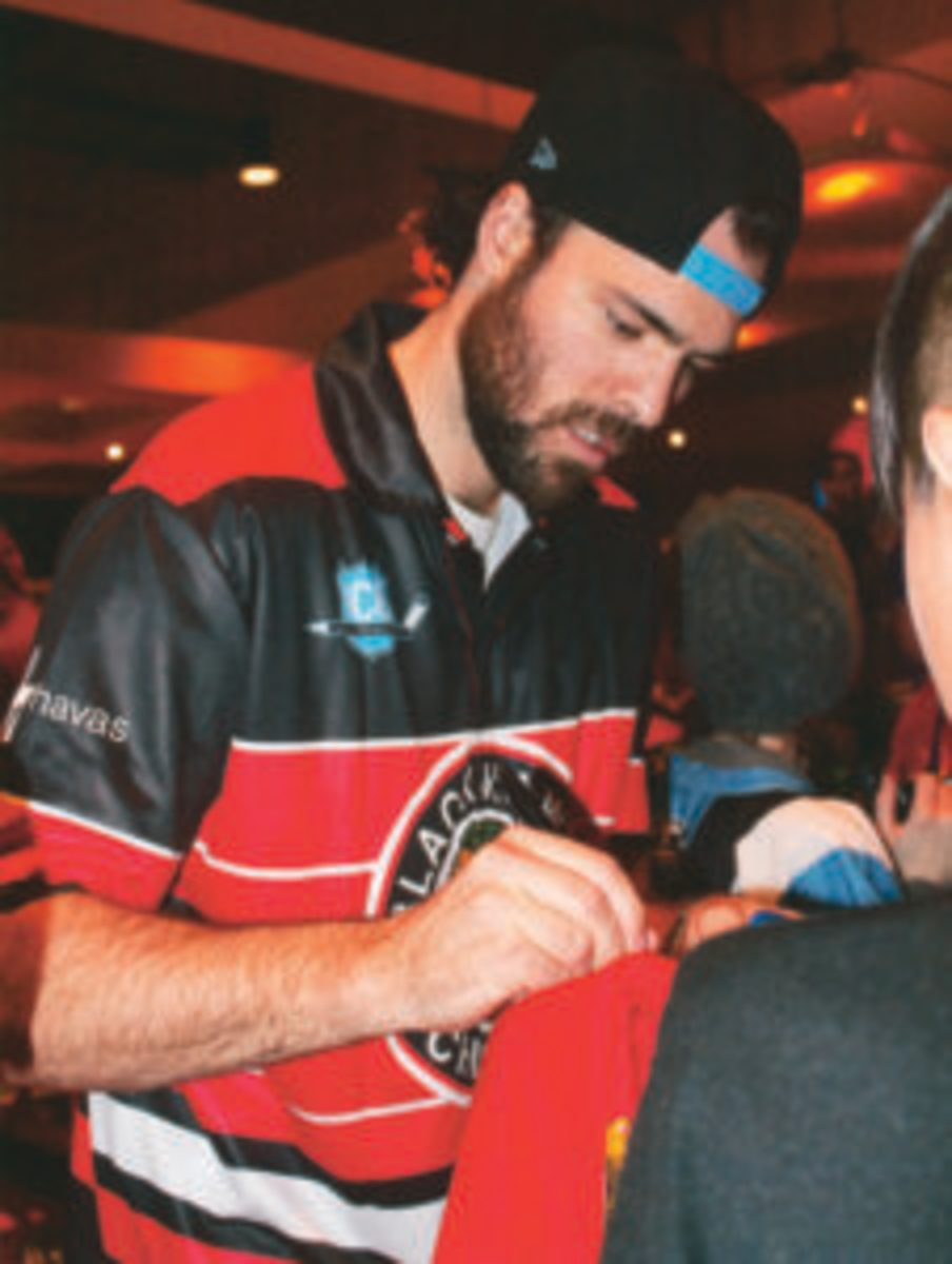 Jan Rutta signs autographs at the ICE Bowl.