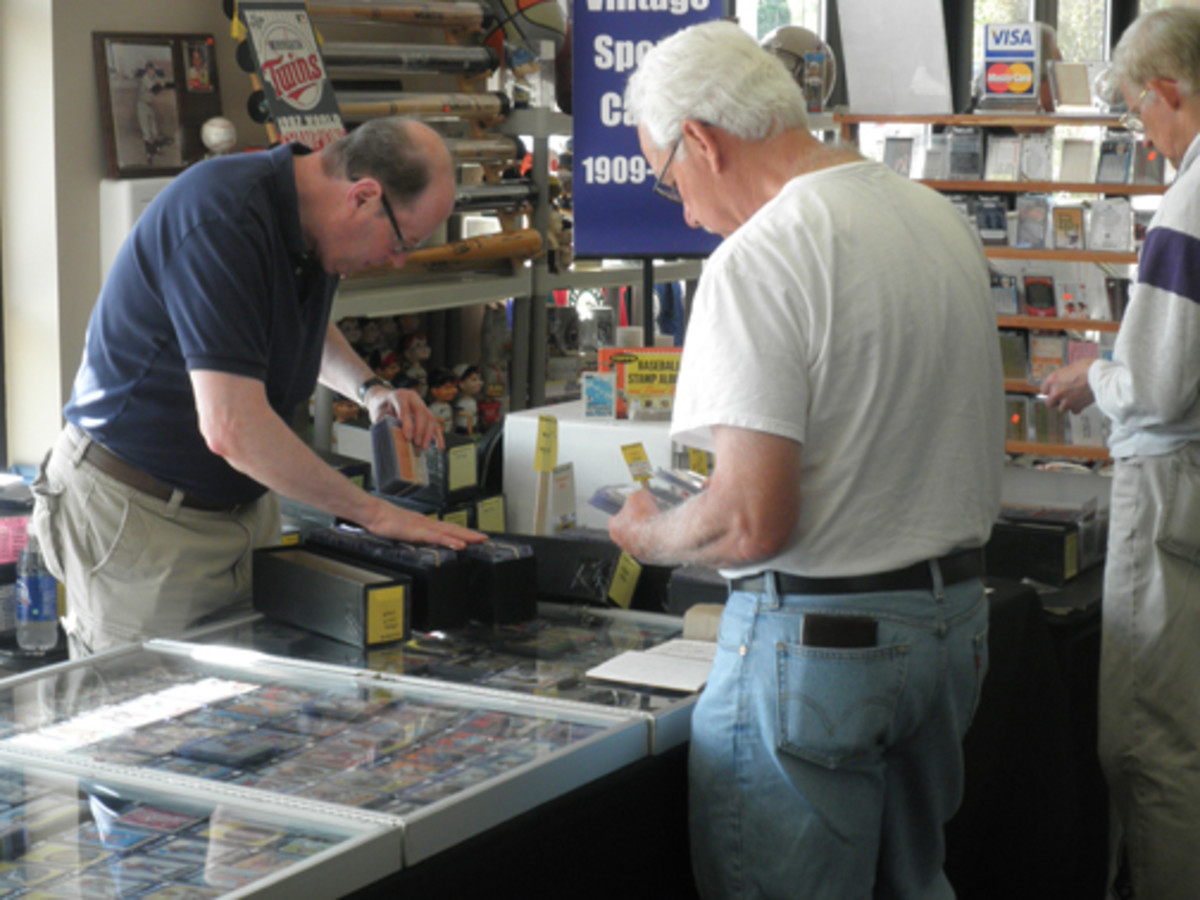 Veteran Twin Cities dealer and club member Rob Hunegs dealing with some vintage cards at a recent show.