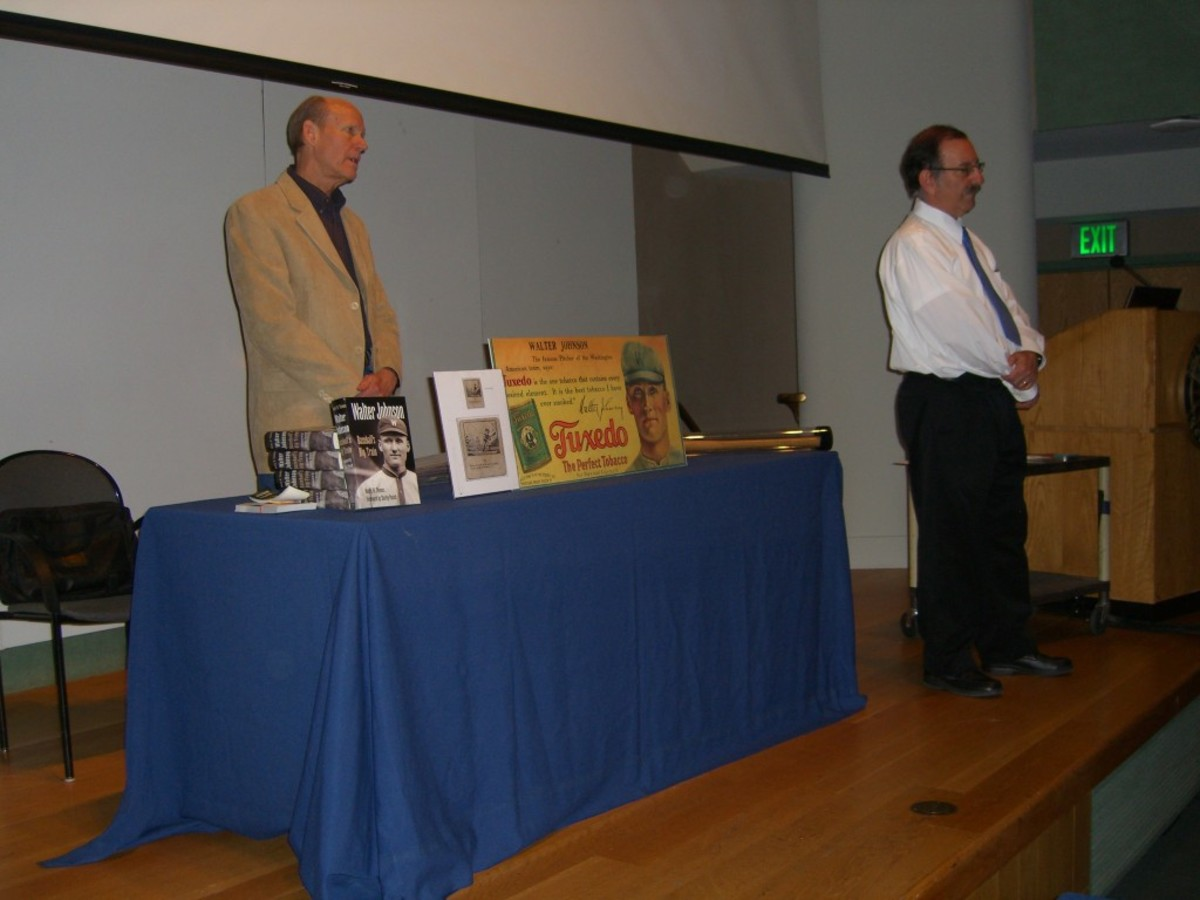 The night's main speakers: Hank Thomas, left, and Frank Ceresi, right, field questions from the audience.