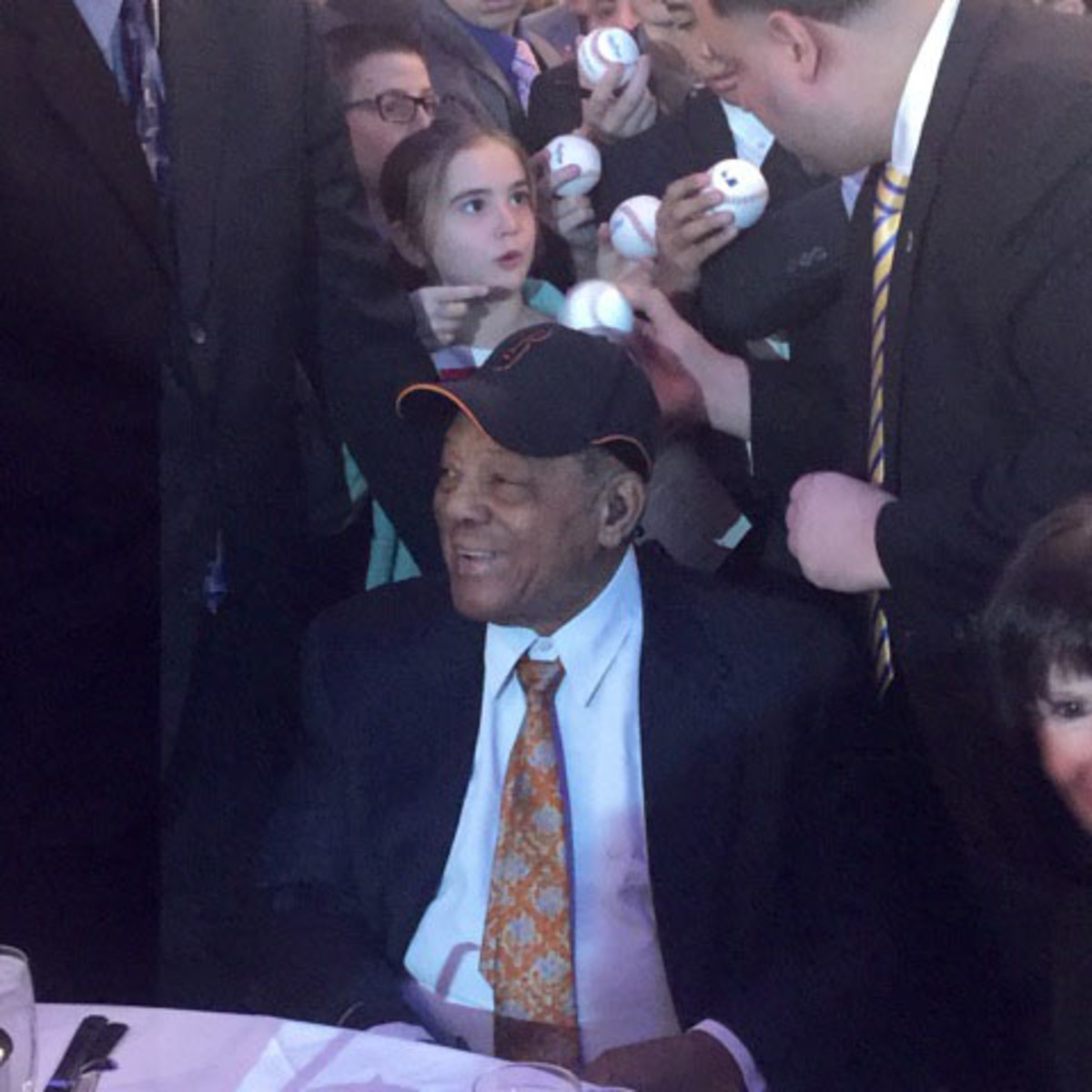 It's a Willie Mays free signing session – for kids only. A few dozen got lucky as Mays signed at his table on the main floor.