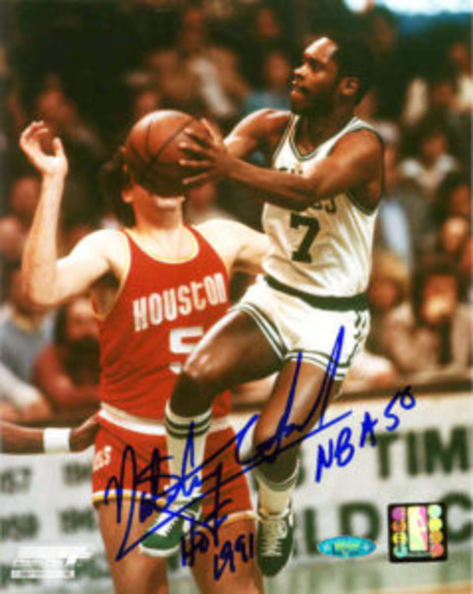 "A Nate Archibald autograph that includes the inscriptions ""HOF 1991"" and ""NBA 50."""