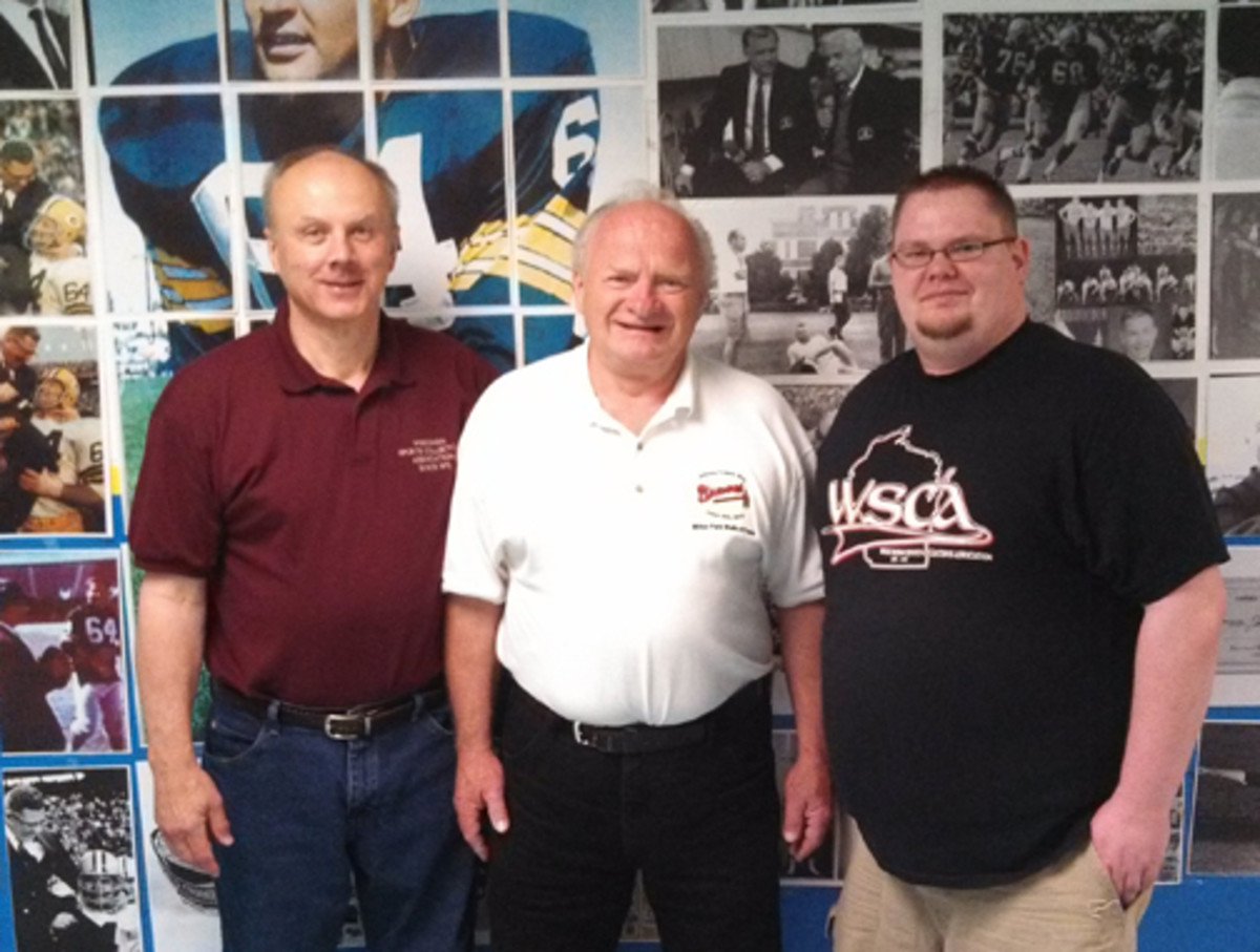 Bob Ruesch, Mike Rodell and Keith Kilps of the Wisconsin Sports Collectors Association.