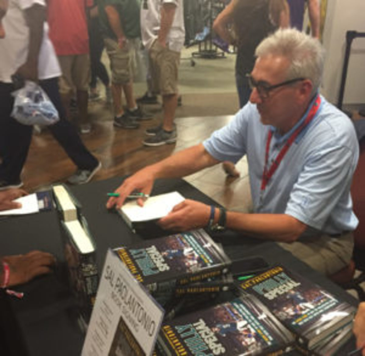 ESPN's Sal Paolantonio signs copies of his book at the Pro Football Hall of Fame. (Barry Blair photo)