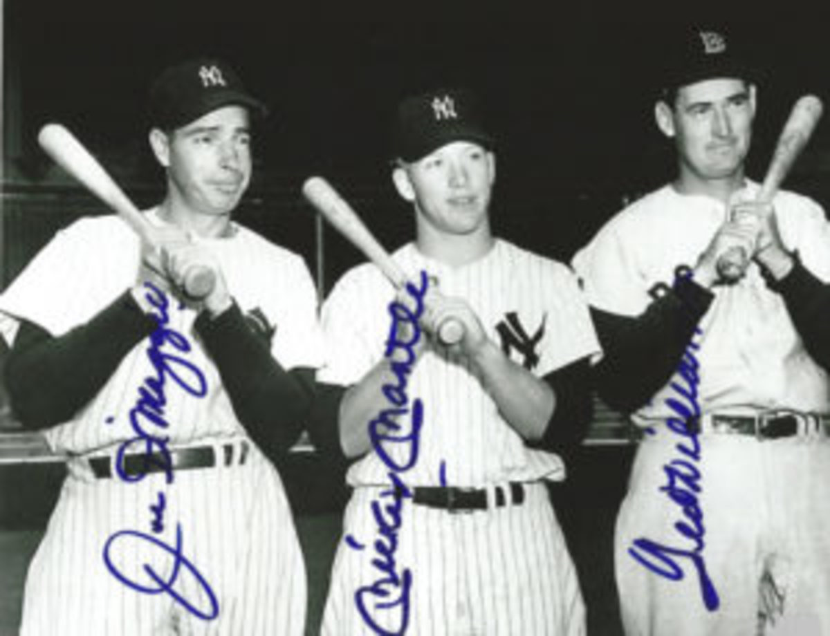 This photo featuring Joe DiMaggio, Mickey Mantle and Ted Williams is probably the most commonly forged photo in the hobby.