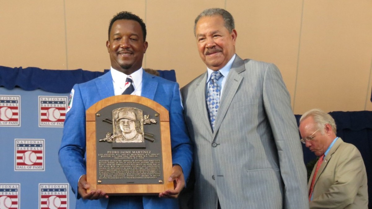 Pedro Martinez, left, danced, then invited fellow Dominican Juan Marichal to join him on stage.