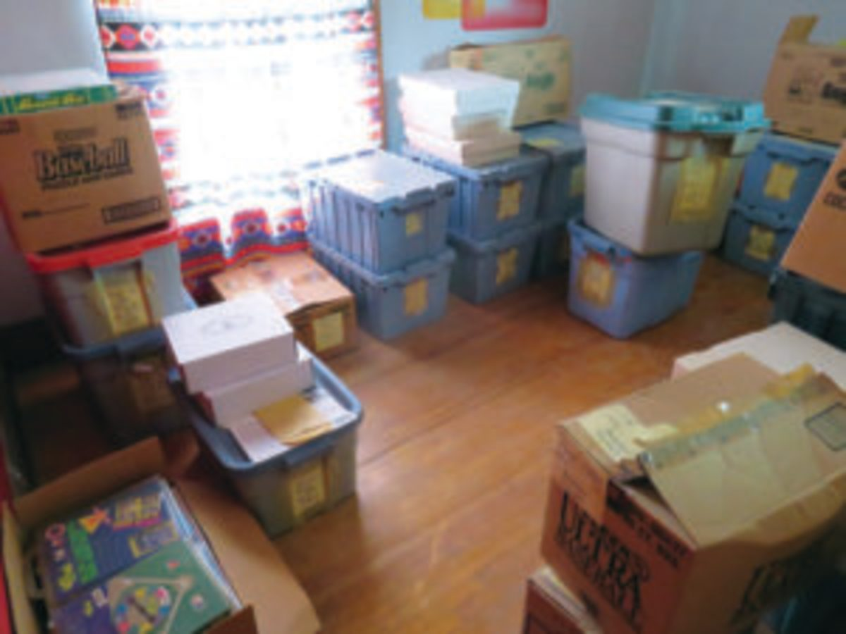 One of the rooms upstairs in the house is filled with boxes and tubs of modern sports trading cards as well as other sports collectibles. Each box and tub contains a label listing the contents.