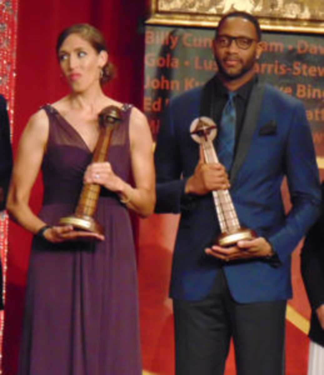 Rebecca Lobo (left) and Tracy McGrady (right) at the Naismith Basketball Hall of Fame Induction ceremony. (Robert Kunz photos)