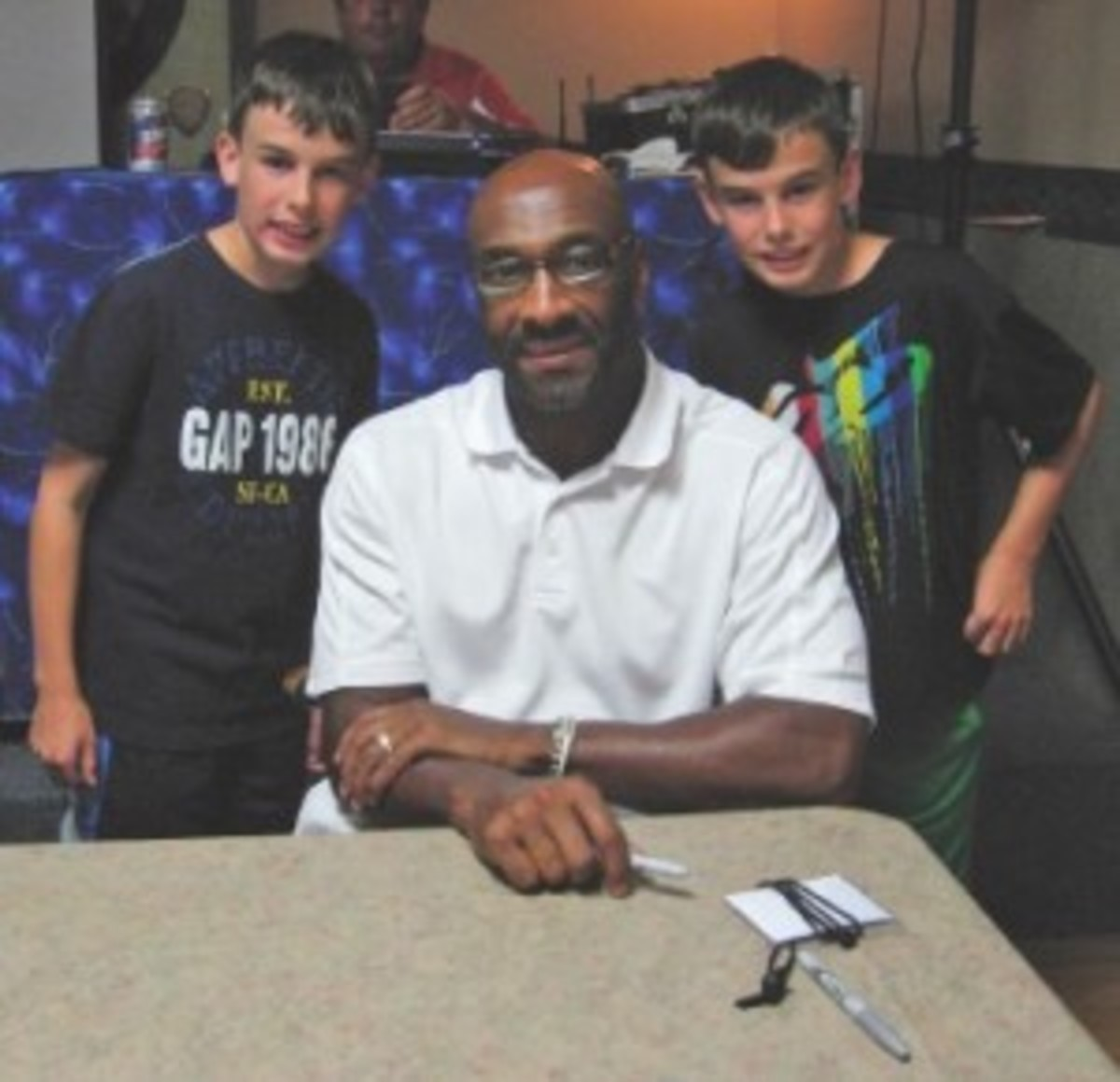 The author's sons, Dalton and Devon, pose with former wide receiver Irving Fryar. Players met in Penn Yan, N.Y., to help raise money for disadvantaged kids in an event headed up by former running back Tony Collins.