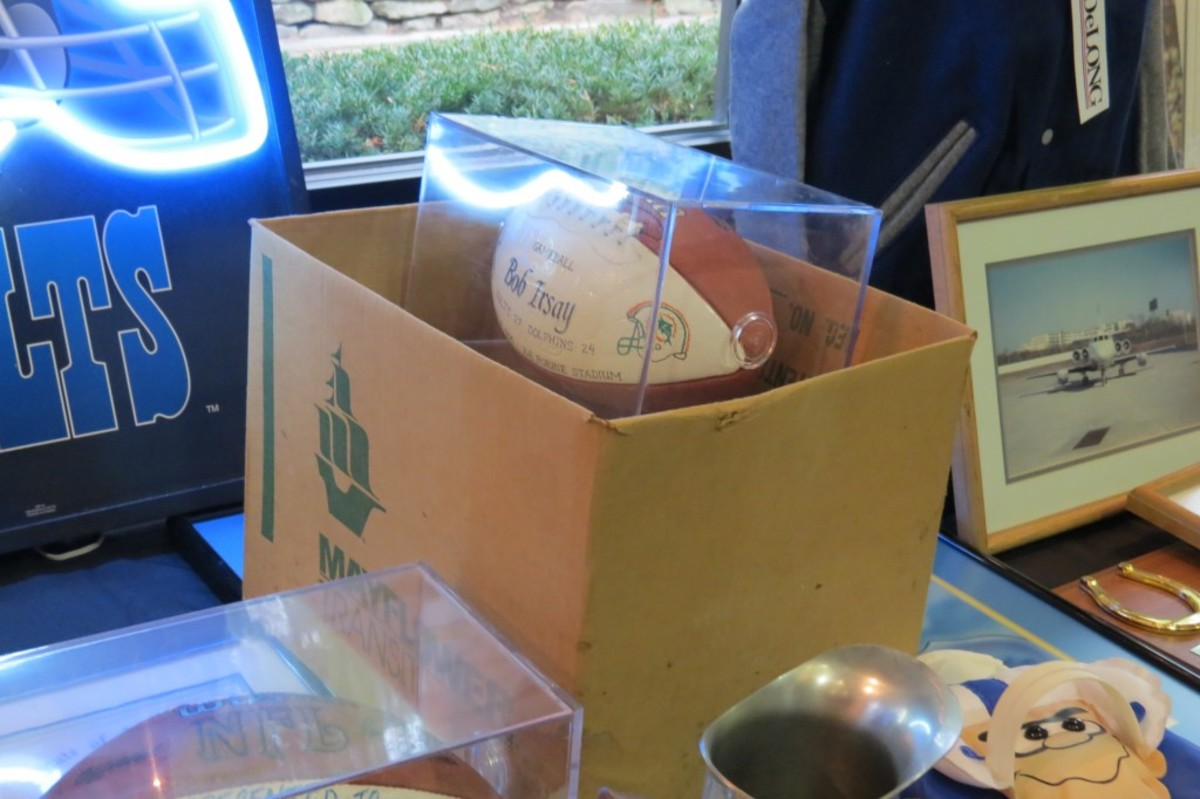 A ball from the Colts-Dolphins game played on Oct. 8, 1995, sits nestled (with other items that were about to be auctioned off) in an original Mayflower box from the March 29, 1984 move of the team from Baltimore to Indianapolis.